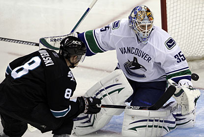 Cory Schneider denies Joe Pavelski a high quality scoring chance, one of 44 saves in 65 minutes of play. (AP)
