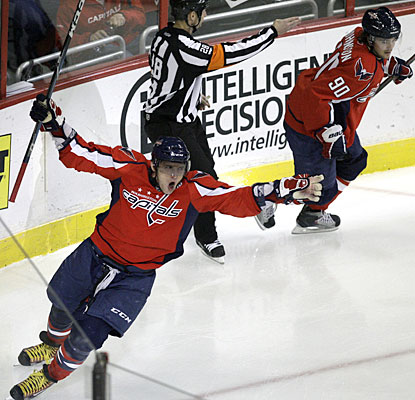 Alexander Ovechkin ties it for Washington with his 28th goal of the season and has points in seven straight games. (AP)