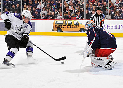 Anze Kopitar fakes goalie Steve Mason to complete his second career three-goal game. (Getty Images)
