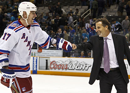 Rangers coach John Tortorella congratulates Brandon Dubinsky for converting his shootout attempt. (US Presswire)