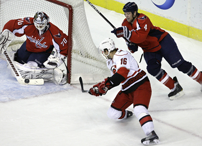 Capitals goalie Braden Holtby blocks a shot from Hurricanes' center Brandon Sutter for one of his 27 saves. (AP)
