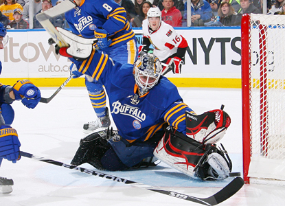 Jhonas Enroth makes a kick save against the Ottawa Senators and goes on to make 34 saves in the win. (Getty Images)