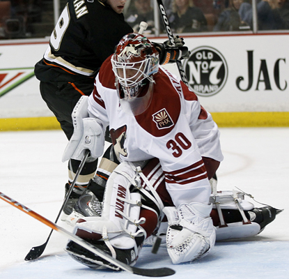 Ilya Bryzgalov makes one of 36 saves against his former team in the Coyotes' win over the Ducks. (AP)
