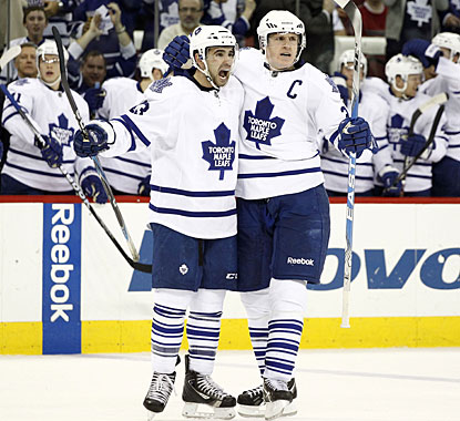 Dion Phaneuf (right) comes up with two power-play goals to help Toronto in its run to make the postseason. (US Presswire)