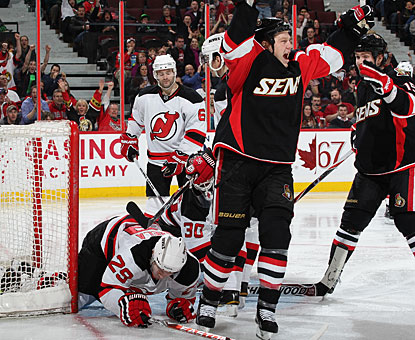 Chris Neil celebrates his first goal of the night and what turns out to be the eventual winner. (Getty Images)