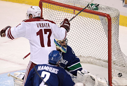 Radim Vrbata skates across as Shane Doan (not pictured) scores the second goal during a five-minute power play. (AP)