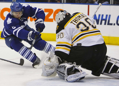 Maple Leafs defenseman Luke Schenn scores on Bruins goalie Tim Thomas in the first period of Toronto's win. (US Presswire)
