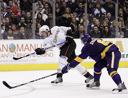 Drew Doughty can't prevent Corey Perry from this shot that beats the goalie with the winning goal. (AP)