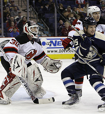 Martin Brodeur makes 13 saves and earns his NHL-record 115th shutout as the Devils win 3-0. (AP)