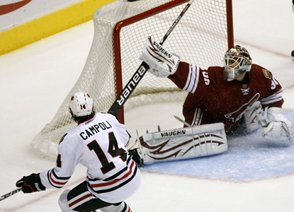 Chris Campoli gets the puck past Coyotes goalie Ilya Bryzgalov for a power-play goal in the third period.  (AP)