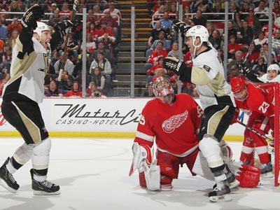The Peguins' Pascal Dupuis (right) celebrates his first of two goals against the Red Wings.   (Getty Images)