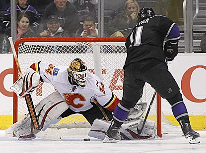 Kings center Anze Kopitar slips the puck between Miikka Kiprusoff's legs to score the deciding shootout goal.  (AP)