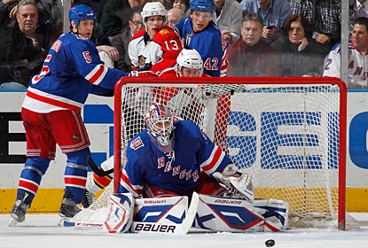 Henrik Lundqvist is not tested too much on the 22 saves he makes for his league-leading 10th shutout. (Getty Images)