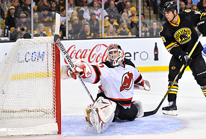 Martin Brodeur can't stop one of four Bruins goals as the Devils lose for the third time in four games. (Getty Images)