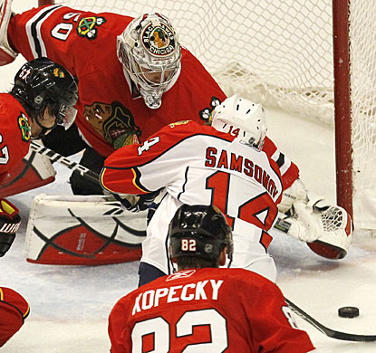 Corey Crawford, who starts for the 18th straight game, stops 23 shots for his fourth shutout this season. (AP)