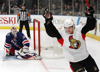 Erik Karlsson celebrates after scoring the game-winning shootout goal against Rangers goalie Henrik Lundqvist. (AP)