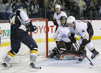 Predators left wing Sergei Kostitsyn, left, scores one of his goals of the night on Ducks goalie Jonas Hiller. (AP)