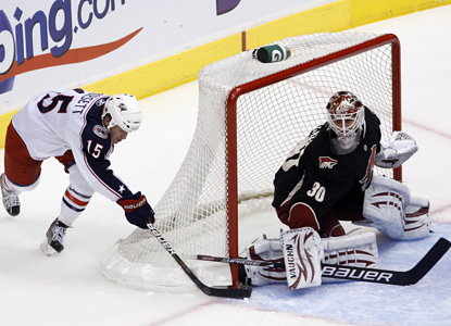 Coyotes goalie Ilya Bryzgalov shuts the door on Derek Dorsett's wraparound attempt en route to a 27-save shutout. (AP)