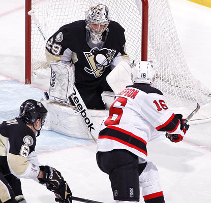 Penguins goalie Marc-Andre Fleury makes a stop on Jacob Josefson for one of his 21 saves against the Devils. (AP)