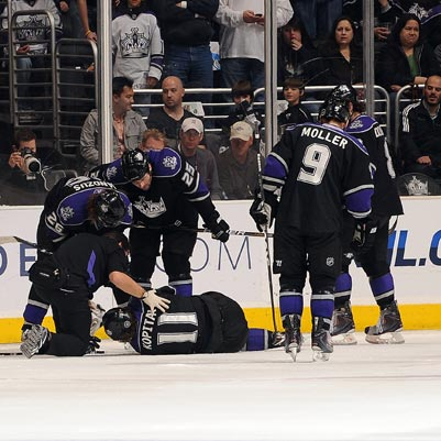 The Kings' leading scorer, Anze Kopitar, leaves the game in the second period with a broken right ankle. (Getty Images)