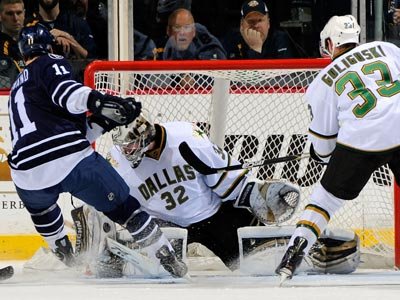 David Legwand (left) scores his first of two goals during a critical win against the Stars.  (Getty Images)