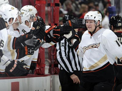 Corey Perry celebrates with teammates after scoring his second of two goals in the third against the Blackhawks.  (Getty Images)