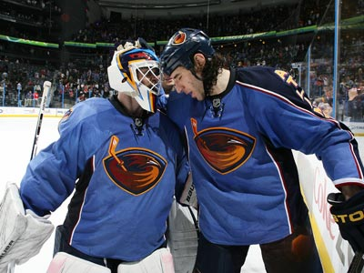 If Chris Mason (left) and the Thrashers have any hope to reach the postseason, they will have to win out. (Getty Images)