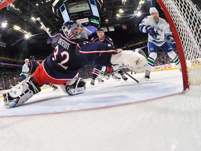 Chris Higgins (right) scores his second goal of the night against Mathieu Garon and the Blue Jackets.  (Getty Images)