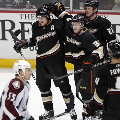 The Ducks' Teemu Selanne (top left) finishes the game with three goals and two assists against the Avalanche.  (AP)