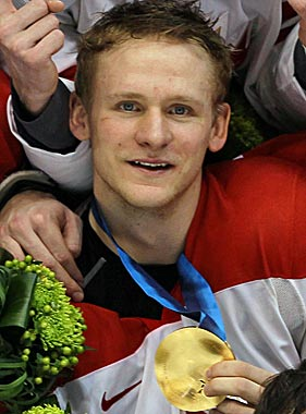Corey Perry shows off the gold he won with Team Canada on Feb. 28, 2010. (Getty Images)