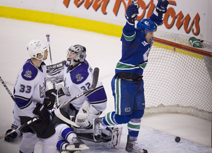 Raffi Torres celebrates as teammate Christian Ehrhoff's shot goes in the net past Kings goalie Jonathan Quick. (AP)