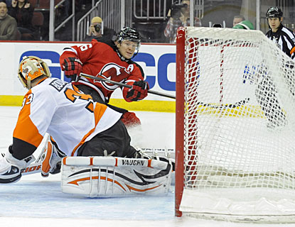 Patrik Elias scores a short-handed goal, his second of the game, before completing his eighth career hat trick. (AP)