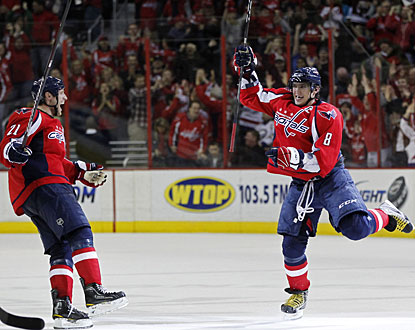 Six seasons in the NHL and for the sixth time Alex Ovechkin (right) registers at least 30 goals.  (US Presswire)