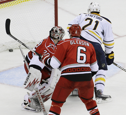 Marc-Andre Gragnani scores the game-winner for the Sabres in overtime in a tense match with the Hurricanes. (AP)