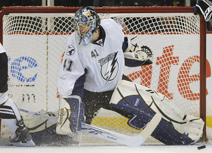 Mike Smith makes a stop against the Blackhawks and goes on to make 31 saves in the Lightning's shutout win. (AP)