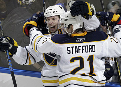 Thomas Vanek celebrates his winning goal, which gets Buffalo into the playoffs, with Drew Stafford. (AP)