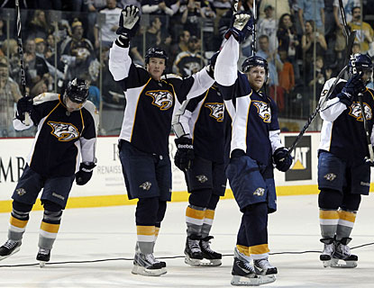 The Predators acknowledge their fans after recording the 24th victory on home ice this regular season. (AP)