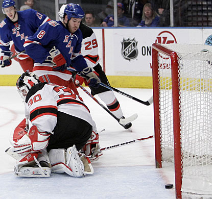 Just off the bench, Brandon Prust (8) charges to the net and is able to put a backhand rebound under Martin Brodeur. (AP)