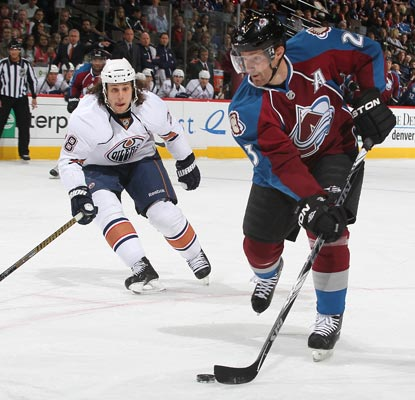 Milan Hejduk (right) records two points against the Oilers during the Avs' season closer.  (Getty Images)