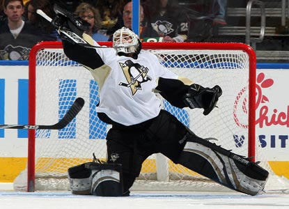 Reserve goalie Brent Johnson saves 37 shots while grabbing his fourth straight decision for the playoff-bound Penguins.  (Getty Images)