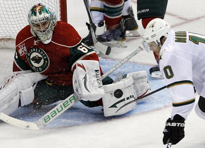 Wild netminder Jose Theodore makes 26 crucial saves, including this one against Dallas LW Brenden Morrow. (Getty Images)