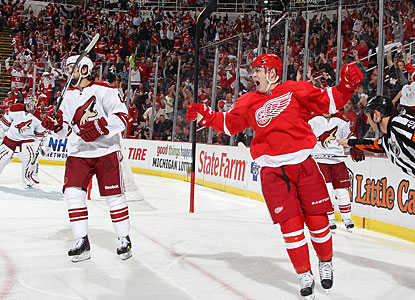 After a good hustle to the puck, Jiri Hudler (right) completes the scoring for Detroit with a goal in the third period. (Getty Images)