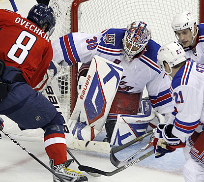 Alex Ovechkin is able to force the puck through Henrik Lundqvist's legs for the equalizer late in the third period. (AP)