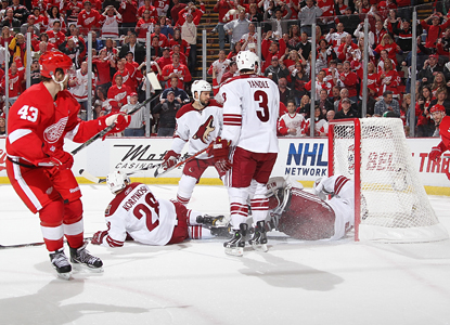 Coyotes players look on as goalie Ilya Bryzgalov lets a shot from Darren Helm (43) get by for a goal in the first period. (Getty Images)