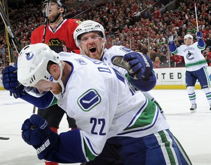 The Sedin brothers combine for a total of four points during a Game 3 win against the Blackhawks.  (Getty Images)