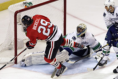After Bryan Bickell scores his first career goal in the postseason, the Blackhawks never look back in Game 4. (AP)