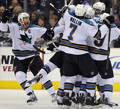 Teammates are all over Devin Setoguchi, who nets the winner and caps an incredible comeback win for the visiting Sharks. (AP)