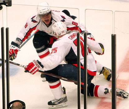 Jason Chimera (25) and Alex Ovechkin realize they are one home victory away from advancing to the next round. (US Presswire)