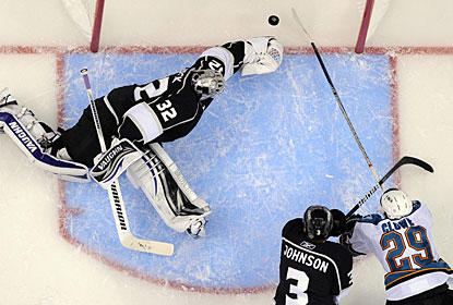 Ryane Clowe beats goalie Jonathan Quick and Jack Johnson to push the puck in the net for his second goal. (AP)