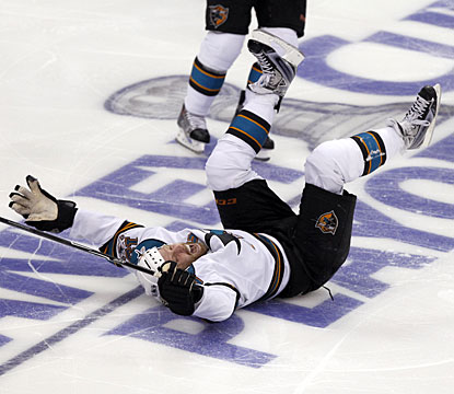 Just like a kid playing on ice, Joe Thornton celebrates his winning goal sliding on his back. (AP)